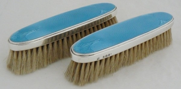 TWO SILVER ENEMAL CLOTHING BRUSHES